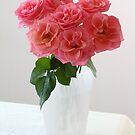 pink roses in vase on table by OldaSimek