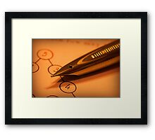 Antique pen on a puzzle Framed Print