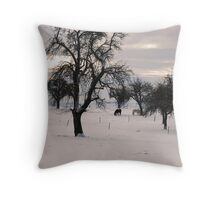 Two horses grazing through the snow in the Swiss Alps Throw Pillow