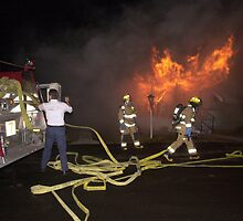 Firefighters arrive at trailer fire by Larry  Grayam