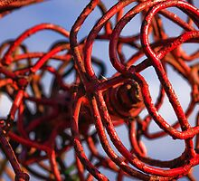 Twisted metal sculpture in red by Susan Leonard