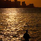 Havana Sunset & lone figure, Cuba  by buttonpresser