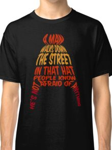 A man walks down the street... Classic T-Shirt