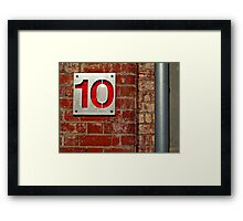 Ten on a Red Wall Framed Print