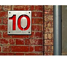 Ten on a Red Wall Photographic Print