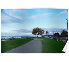 Beautiful crescent beach in late summer in White Rock, BC. Landscape picture of green grasses, blue sky, early fall yellow leaves tree and sea.  Poster