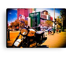 Cruiser Bike in the middle of the market Canvas Print
