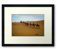 Camel Train through the Desert Framed Print