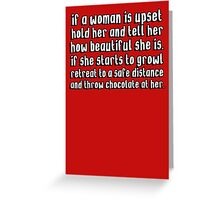 If woman is upset hold her if she starts to growl retreat and throw chocolate at her Greeting Card