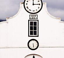 Clock faces facade - Swellendam, South Africa by Fineli