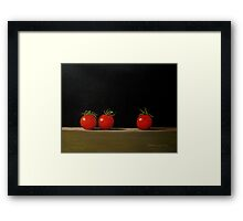 Three Tomatoes On A Shelf Framed Print