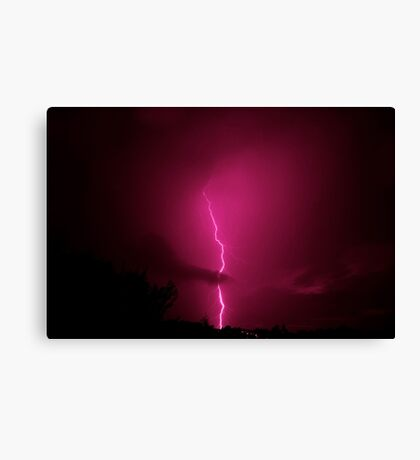 Lightning across a night sky Canvas Print
