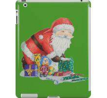Cute santa and toys wrapping Christmas gifts iPad Case/Skin