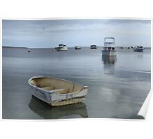 Dinghy refecltion on calm ocean Poster