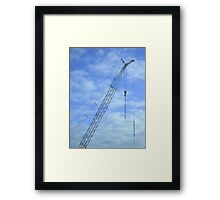 Spinning the SpiderWeb (jib against sky)  Framed Print