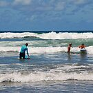 Surf lessons at Kuta Beach by Adri  Padmos