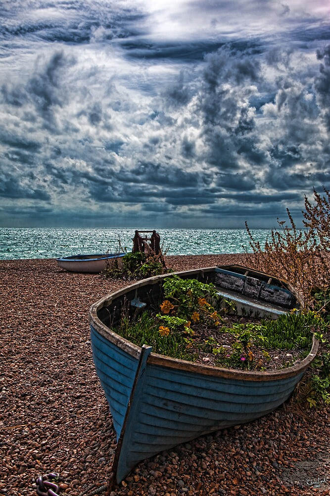 Old Beached Fishing Boats On a Cloudy Day by Chris Lord