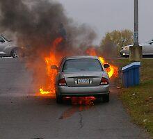 Fire in the car.... by Larry Llewellyn