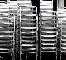 Empty Stacked Stainless Steel Chairs by Paul Marotta