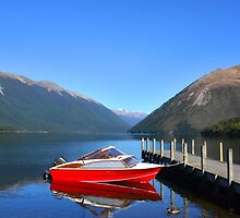 An old model wooden red boat on Lake Rotoiti in New Zealand 1 by Seesee
