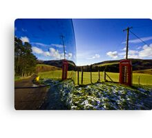 Red phonebooth and Scottish landsape reflecting in a convex mirror Canvas Print