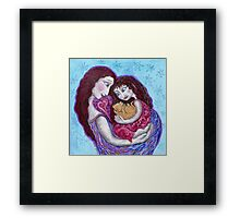 Cradled moment Framed Print