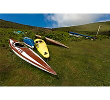 Abandoned canoes Photographic Print