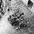 Tourists on ancient paved courtyard -- Dubrovnik, Croatia by Sheldon Levis