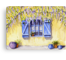 Yellow facade - blue shutters Canvas Print