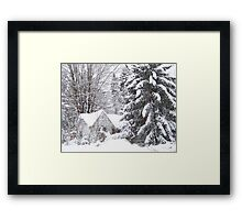 Abandoned house covered by a blizzard. Framed Print