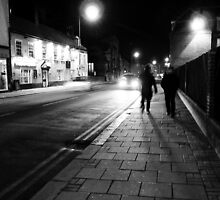 Walking through town at night by fotdmike
