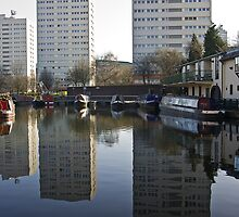 Boats, buildings and reflections by Steve plowman