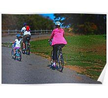 Family riding bikes in Shoreline park Poster