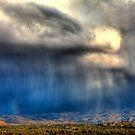 Rain over Catalina Mountains, Tucson AZ by Kenn Jensen