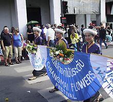 Thai Ladies Carrying Blue Banner. by Mywildscapepics
