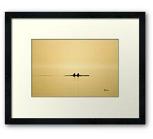 rowing at dusk Framed Print