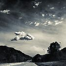 The road and the cloud by Silvia Ganora