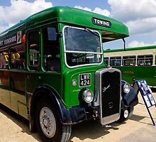 Green towing bus by buttonpresser