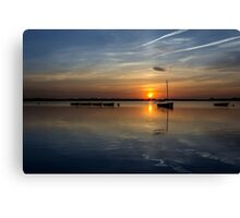 Boats on the lake at sunset Canvas Print