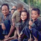 Hmong man with a bunch of grandchildren. Thailand by John Spies