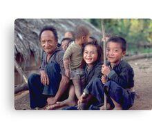 Hmong man with a bunch of grandchildren. Thailand Canvas Print