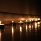 Tealights on the floor by Hege Nolan