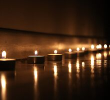 Tealights on the floor by Hege Nolan