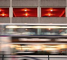 Running bus (car park as a background) by Denis Kovalenko