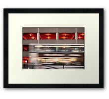 Running bus (car park as a background) Framed Print