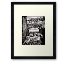 Grinding out the stone Framed Print