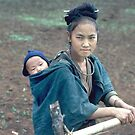 Teenage Hmong mother by John Spies