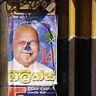 Poster and shopfront, Kochchikada, Sri Lanka by Syd Winer