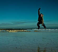 Jumping at the beach by KevinNoon