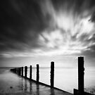 Groynes under a fleeting sky by postmansmith